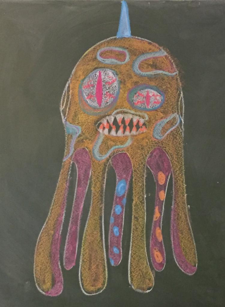 Le commencement du monstre... Un peu de craie, un tableau noir et de l'imagination; voilà le premier portrait de notre Rababou... Maintenant au travail.